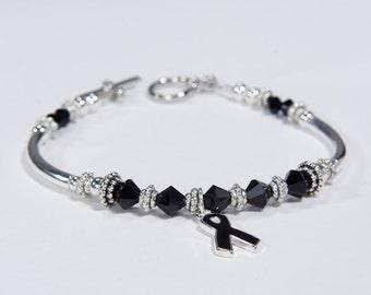 Black Ribbon Charm Bracelet: Awareness for Melanoma, Skin Cancer Awareness, Sleep Disorders, Anti-Terrorism // support, survivor // crystals