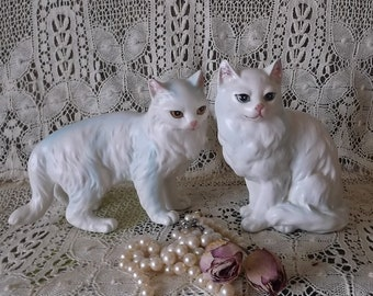 Vintage pair of iridescent blue mischievous cats