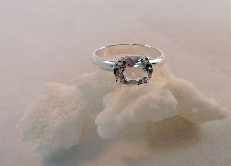 This oval green amethyst stone is set in solid sterling silver and is in a size 6.