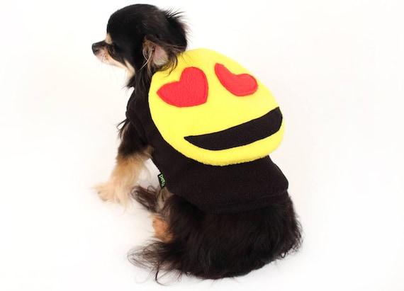 Small dog wearing an emoji costume.