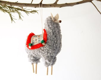 stuffed puffy peruvian llama christmas ornament with fringed blanket saddle gray with red fringe