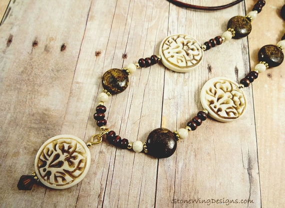 Rustic Carved Bone, Bronzite, Riverstone and Leather Necklace Featuring a Carved Lotus Pendant