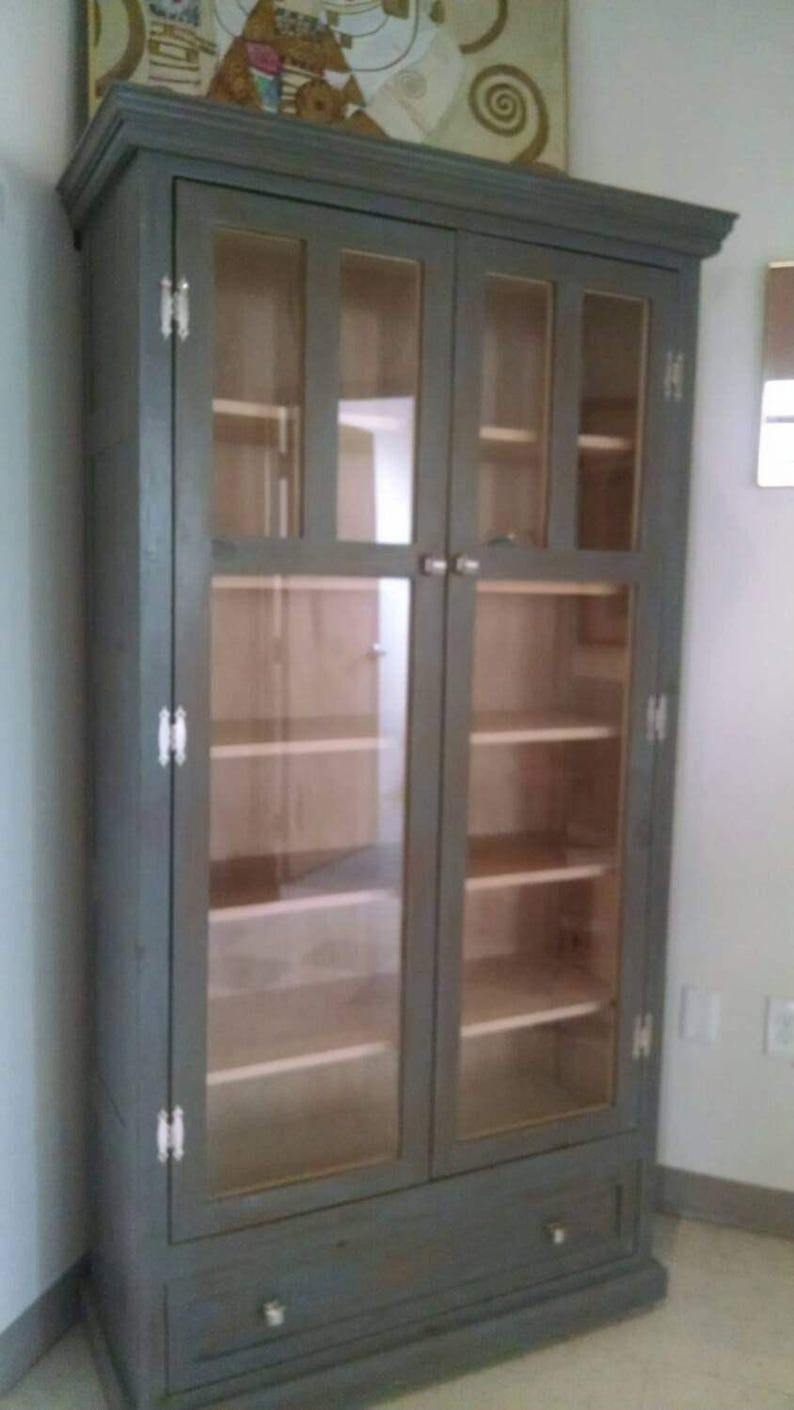 . Large display or storage cabinet ready to go  sale price  discounted for  the season  deep discount for fast sale  Delivery next week