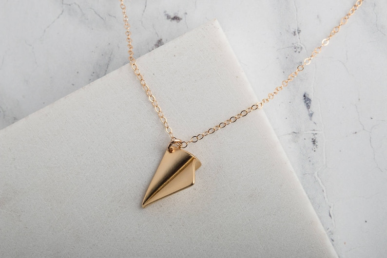 Gold paper aeroplane charm necklace gold charm necklace image 0