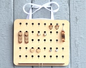 Wood earrings organizer. ...