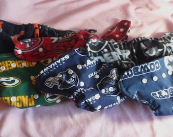 Choose your custom team and style cloth diaper.OS pocket diaper or cover with rival team inner,two teams combo or add ruffles. Made to order