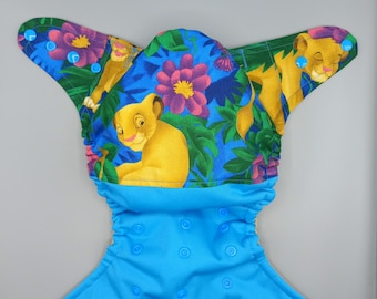 Cloth diaper SassyCloth one size pocket diaper with baby lion king cotton print (2). Ready to ship.