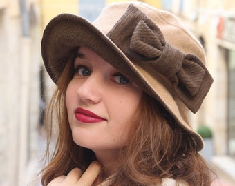 da5899558ef Beige bucket hat with brown bow. Fabric hat with a wide brim and bow  detail. Wide brim pillbox hat. Womens warm winter church hat.
