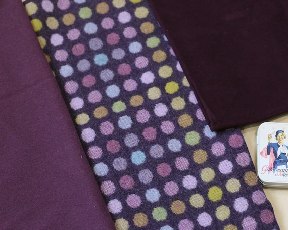 One-off pack of THREE pieces of toning fabric in shades of aubergine, heather and plum, with Welsh wool, English moleskin and vintage wool