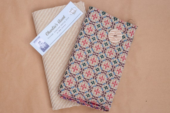 One-off pack with reversible Welsh wool tapestry, heavy weight diagonal weave tweed and a large button in beige, natural, pink and blue