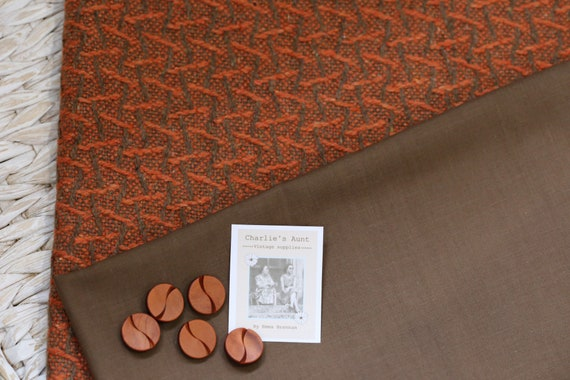 One-off pack of TWO pieces of toning fabric in shades of orange and chocolate, one heavy wool and one polycotton plain, plus five buttons