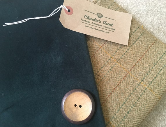 TWO pieces of toning fabric in shades of camel and teal, one vintage wool tweed and one English cotton velvet plus a big wooden button