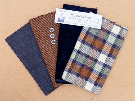 One-off pack with pieces of British wool plaid and diagonal weave tweed, Sudbury silk, velvet and vintage buttons in navy, tan and cream