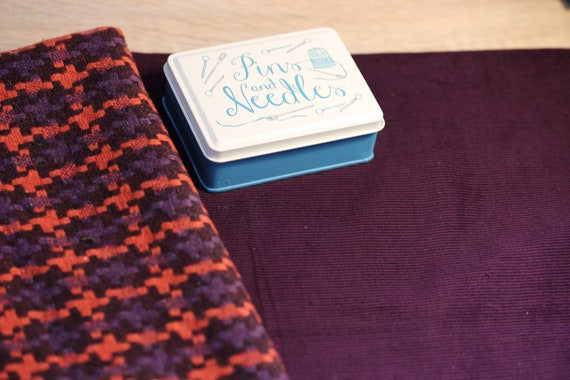 One-off pack of TWO pieces of toning fabric in shades of aubergine and orange, one fancy wool tweed and one British woven cotton corduroy
