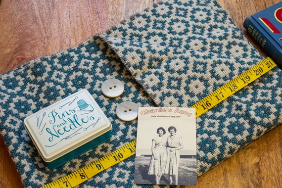 Piece of Welsh wool tapestry fabric in aqua, cream and  grey, plus two vintage buttons