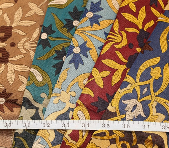 "A one-off stunning English woven silk fabric sampler length in a mix of colours, measuring 18"" x 40"" in a medium weight"
