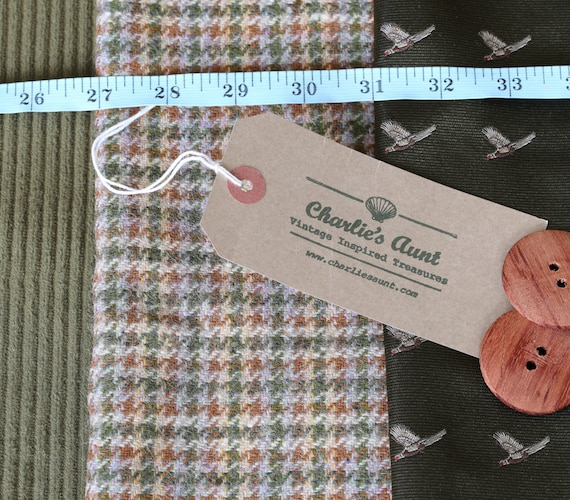 British fabric pack with houndstooth tweed, cotton corduroy and Sudbury silk in olive green tones plus two large wooden buttons