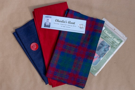 One-off pack with wool tweed plaid, English cotton moleskin, lightweight wool flannel and three buttons in berry red, navy and spruce green