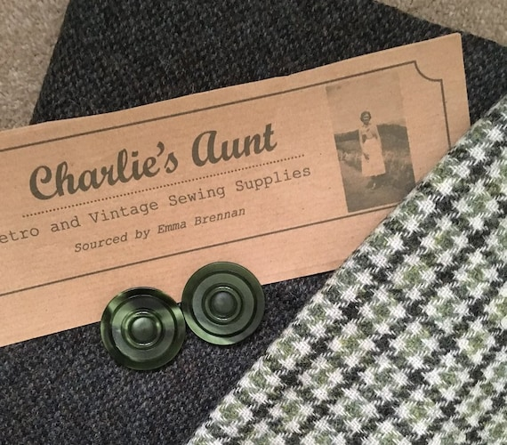 "Two pieces of British wool tweed in tones of green, one plainer in 18"" x 60"" and one in  houndstooth 20"" x 30"" plus 2 vintage buttons"