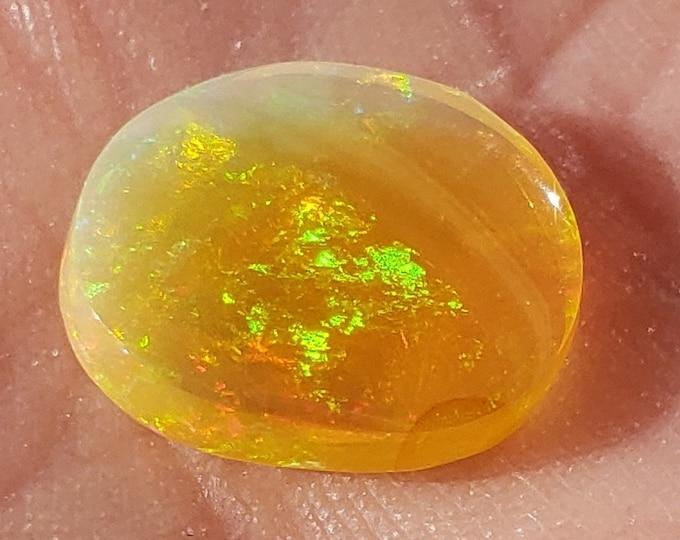 2.2 Ct. Ethiopian Welo Opal - Golden/Yellow Base - 11.3 x 9.4 mm