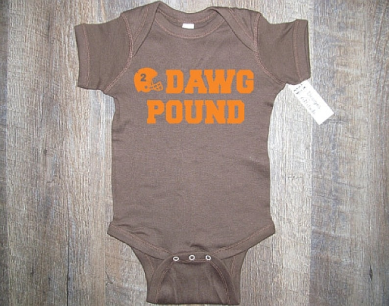 2d9aa6638df Adorable Browns Baby Dawg Pound Baby One piece bodysuit