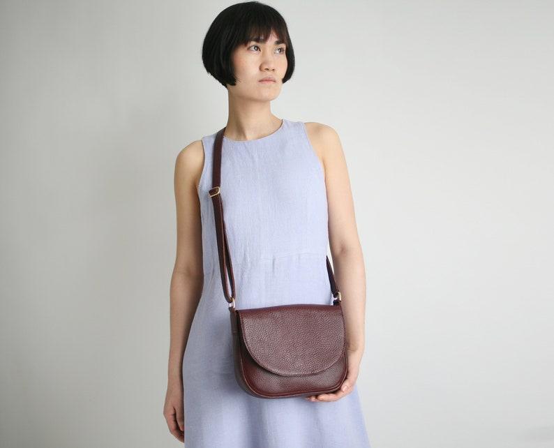 Saddle Bag Bordeaux Leather crossbody bag minimalistic image 0