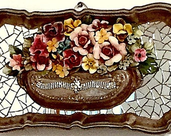 Vintage silver plated tray, repurposed as shabby chic wall decor.  Mirror mosaic background withporcelain flowers and jeweled accent