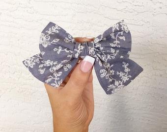 Grey floral pinwheel bow