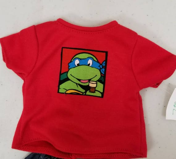 Ninja Turtle T-shirt and denim pants