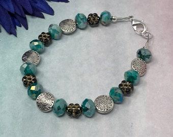 beaded bracelet, peacock green glass beads, silver sun beads, and Czech glass daisies, handmade, new