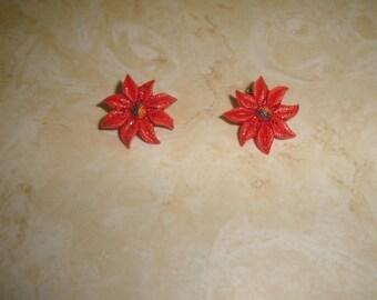 vintage clip on earrings lucite poinsettia christmas flower