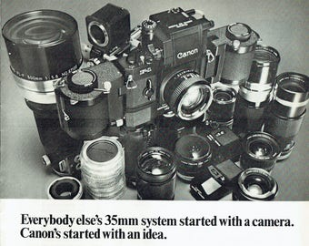 1971 Advertisement Canon Cameras and Lenses 70s SLR 35mm Photography Studio Lenses Kit Black and White Wall Art Decor