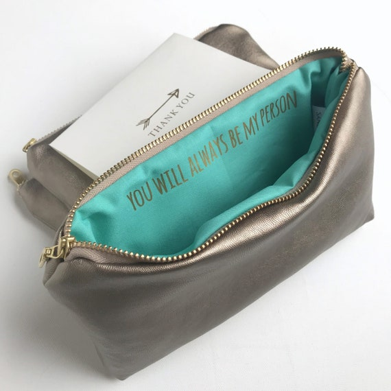 do you take a clutch bag to graduation