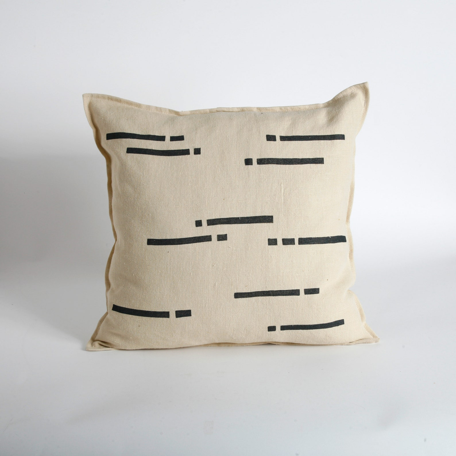 black and tan striped throw pillow