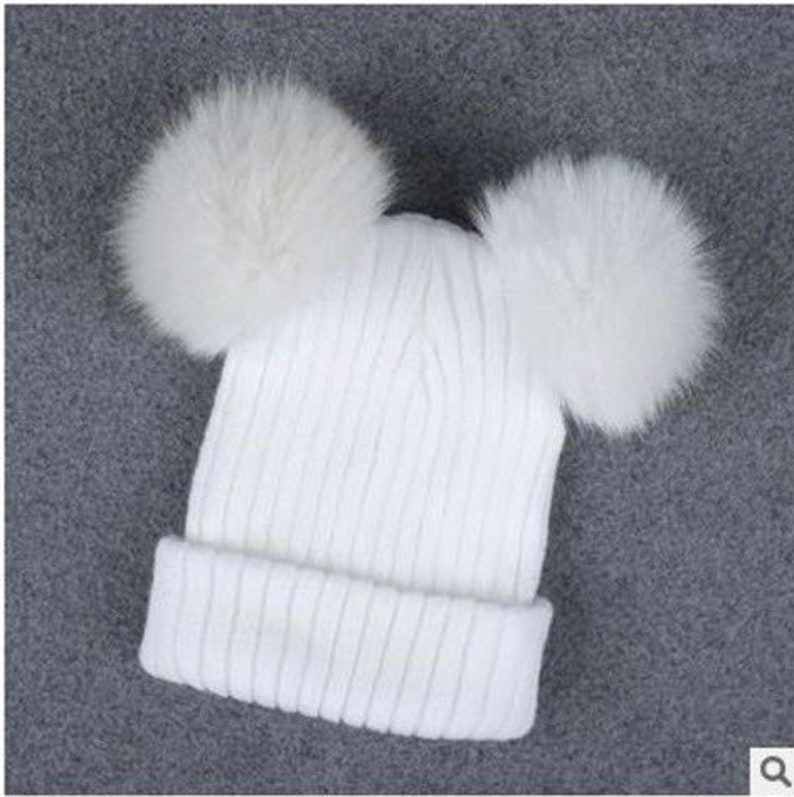 fd354491027 Chunky Knit Hat With Two Faux Fur Pom Poms Beanie