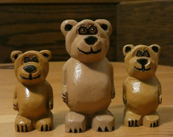 Mama bear and her cubs, carved wood figurines