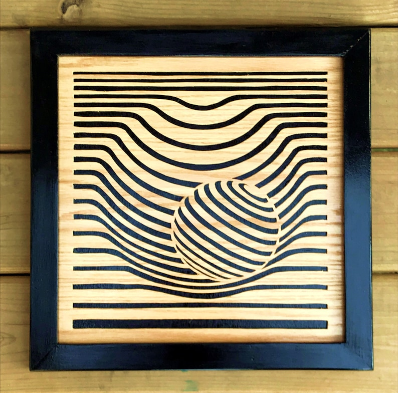 Orbs an optical illusion in wood 3d appearance scroll saw image 0