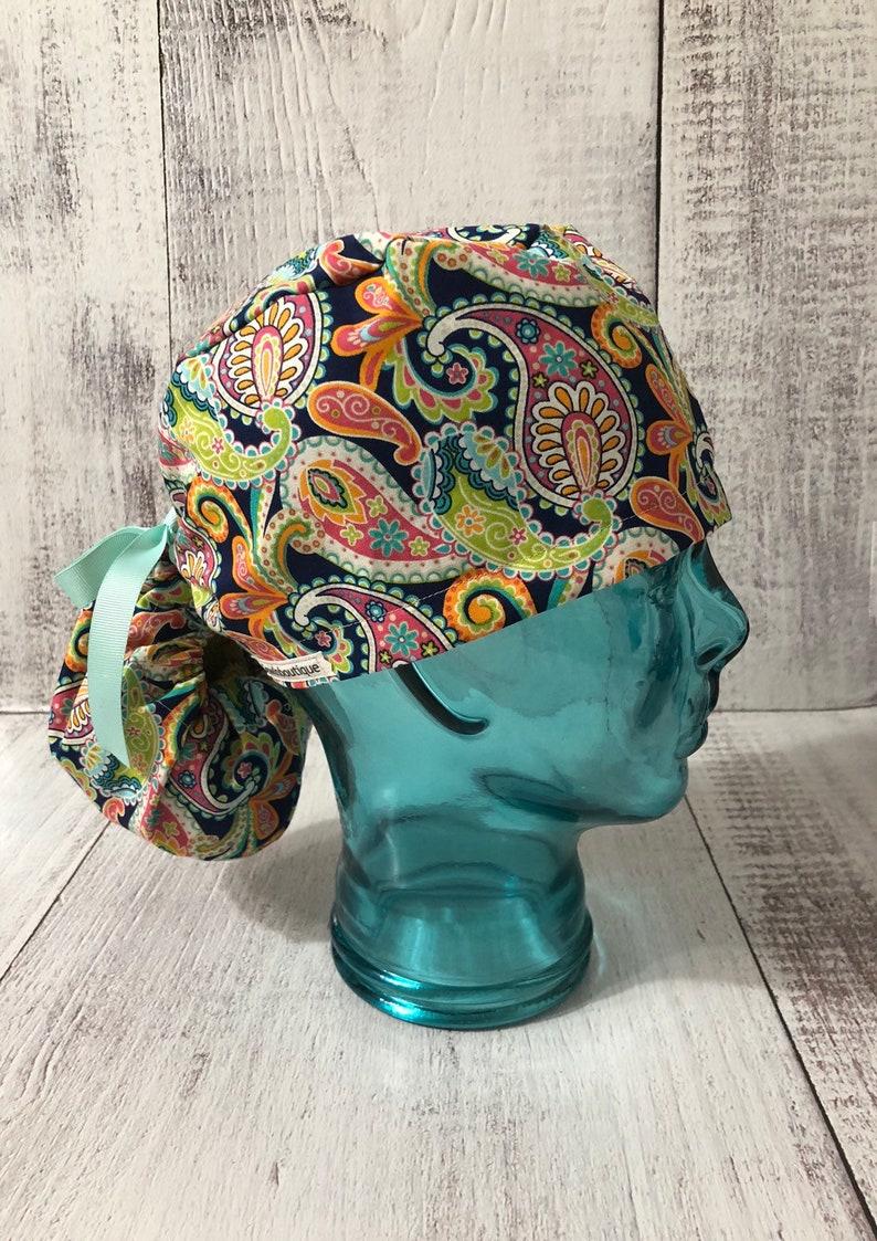 635a9c4c1f5 Multicolor paisley ponytail scrub cap  O R Surgical scrub