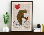 Grizzly Bear riding a bike printed on Vintage Book Page perfect for gifts  ANI222b