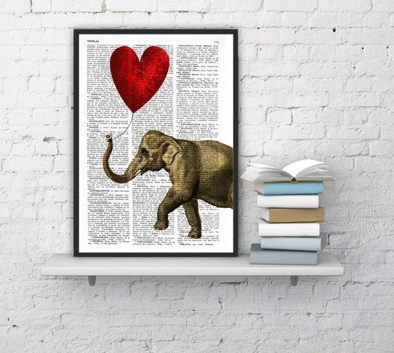 Elephant with a Heart shaped balloon on Vintage dictionary book page perfect for Christmas gifts ANI083b