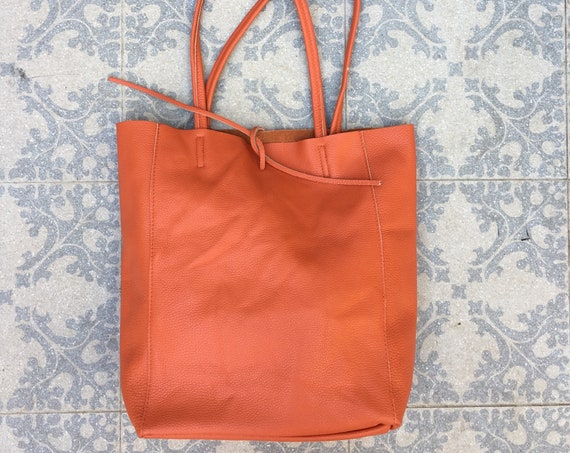 Tote bag in burnt ORANGE with tiny SCRATCH on strap, only 1 piece. Genuine leather bag. Laptop bag, office bag to carry your tablet or books