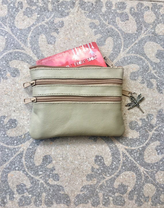 Small purse in LIGHT  BEIGE.  Genuine leather, 4 zippers. Fits credit cards, coins, bills. light brown leather wallet.