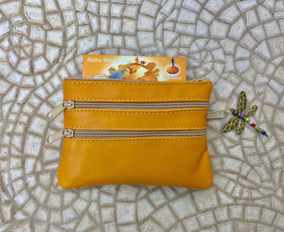 Small purse in MUSTARD YELLOW, genuine leather, closed by 3 beige zippers. Fits creditcards, coins, bills. YELLOW leather wallet.