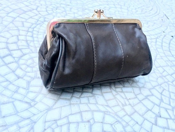 Kiss lock  purse in dark BROWN leather. Cosmetics bag  in CHOCOLATE brown.  Soft leather clip purse, small bag in BROWN. Grandma purses