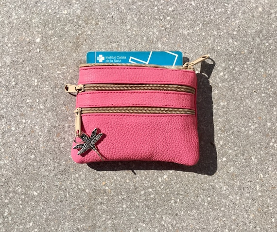 Small purse in shocking PINK . Genuine leather, 3 zippers. Fits credit cards, coins, bills. PINK  color leather wallet.