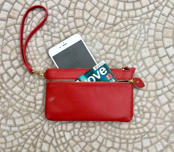 Wristlet purse in RED . Genuine leather, 2 zippers. Fits iphone plus and credit cards, coins, bills. RED color leather wallet.