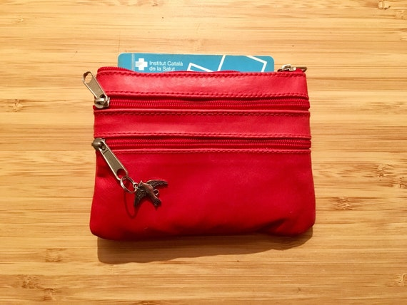 Small purse in RED, genuine leather, 4 zippers. Fits credit cards, coins, bills. Bright RED leather wallet.