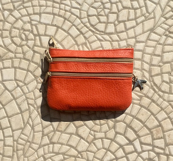 Small purse in burnt ORANGE, genuine leather, 4 zippers. Fits credit cards, coins, bills. ORANGE leather wallet with SWALLOW charm