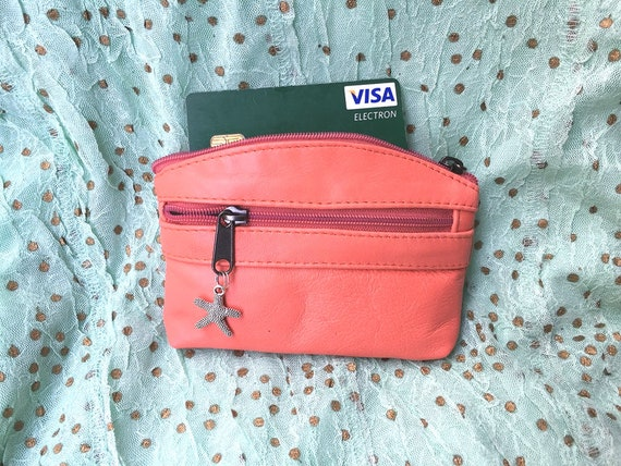 Small purse in CORAL PINK, genuine leather, closed by 3 zippers. Fits credit cards, coins, bills. Salmon color leather wallet.