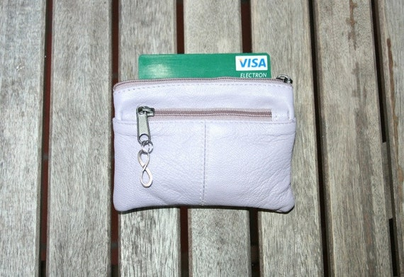 Small purse in LAVENDER color  genuine leather, closed by 3 zippers. Fits creditcards, coins, bills. Soft lilac leather wallet.